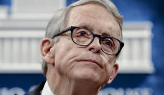 """FILE - In this Aug. 6, 2019, file photo, Ohio Gov. Mike DeWine pauses while speaking at the Ohio Statehouse in Columbus, Ohio. DeWine outlined Thursday, March 18, 2021, the state's multi-pronged plan it's using to fight COVID-19, and the optimistic, downward trend of coronavirus cases and hospitalizations in the state while warning residents that the battle still """"has to be fought every single day."""" (Joshua A. Bickel/The Columbus Dispatch via AP, File)"""