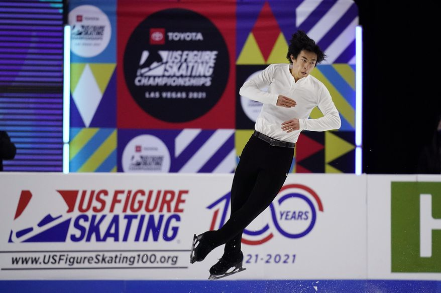 """FILE - In this Saturday, Jan. 16, 2021, file photo, Nathan Chen competes during the men's short program at the U.S. Figure Skating Championships in Las Vegas. As Nathan Chen seeks a third straight World Figure Skating Championships title, something no American has achieved since Scott Hamilton got his fourth in a row in 1984,  he has two major challenges in front of him. One is two-time Olympic gold medalist Yuzuru Hanyu of Japan, who Chen calls """"the benchmark.""""  The other is idleness in major competitions forced by the coronavirus pandemic. (AP Photo/John Locher, File)"""