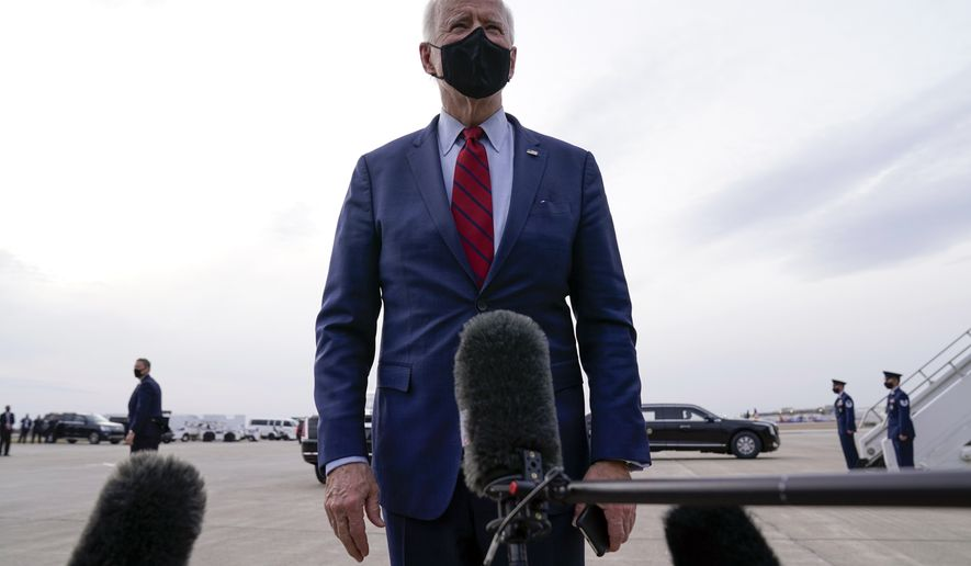 President Joe Biden talks to members of the press before boarding Air Force One on departure from John Glenn Columbus International Airport, Tuesday, March 23, 2021, in Columbus, Ohio. (AP Photo/Evan Vucci)