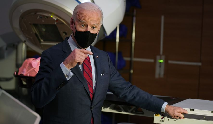 President Joe Biden speaks during a tour of the James Cancer Hospital and Solove Research Institute, Tuesday on the campus of The Ohio State University Tuesday, March 23, 2021, in Columbus, Ohio. (AP Photo/Evan Vucci)