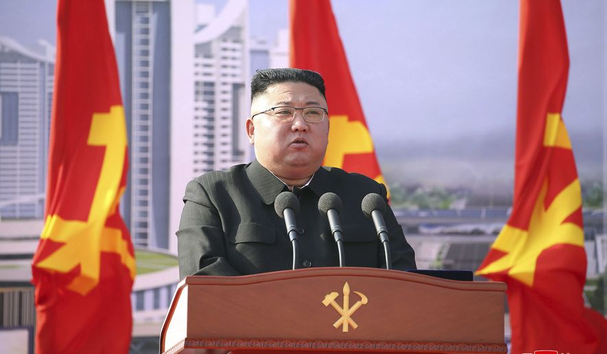 "In this photo provided by the North Korean government, North Korean leader Kim Jong Un speaks during a ceremony to break ground for building 10,000 homes, in Pyongyang, North Korea, Tuesday, March 23, 2021. The White House says North Korea fired short-range missiles this past weekend, just days after his sister Kim Yo Jong threatened the United States and South Korea for holding joint military exercises. Independent journalists were not given access to cover the event depicted in this image distributed by the North Korean government. The content of this image is as provided and cannot be independently verified. Korean language watermark on image as provided by source reads: ""KCNA"" which is the abbreviation for Korean Central News Agency. (Korean Central News Agency/Korea News Service via AP)"