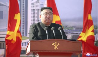 """In this photo provided by the North Korean government, North Korean leader Kim Jong-un speaks during a ceremony to break ground for building 10,000 homes, in Pyongyang, North Korea, Tuesday, March 23, 2021. The content of this image is as provided and cannot be independently verified. Korean language watermark on image as provided by source reads: """"KCNA"""" which is the abbreviation for Korean Central News Agency. (Korean Central News Agency/Korea News Service via AP) ** FILE **"""