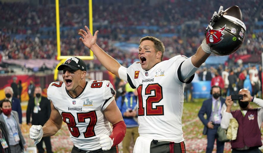 In this Sunday, Feb. 7, 2021, file photo, Tampa Bay Buccaneers tight end Rob Gronkowski (87), left, and Tampa Bay Buccaneers quarterback Tom Brady (12) celebrate together after the NFL Super Bowl 55 football game against the Kansas City Chiefs in Tampa, Fla. (AP Photo/Steve Luciano, File) ** FILE **