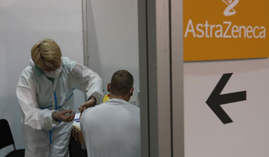 """A person recieves the AstraZeneca COVID-19 vaccine in Belgrade, Serbia, Tuesday, March 23, 2021. American federal health officials say results from a U.S. trial of AstraZeneca's COVID-19 vaccine may have included """"outdated information"""" and that could mean the company provided an incomplete view of efficacy data. (AP Photo/Darko Vojinovic)"""
