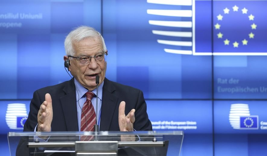 European Union foreign policy chief Josep Borrell speaks during a media conference after a meeting of EU foreign ministers at the European Council building in Brussels, Monday, March 22, 2021. The European Union imposed Monday sanctions on four Chinese officials accused of responsibility for abuses against Uyghur Muslims, provoking swift retaliation from Beijing. (Aris Oikonomou, Pool via AP)