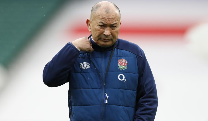 England's head coach Eddie Jones watches his players warm-up before the Six Nations rugby union match between England and France at Twickenham Stadium, London, Saturday, March 13, 2021. (AP Photo/Alastair Grant)