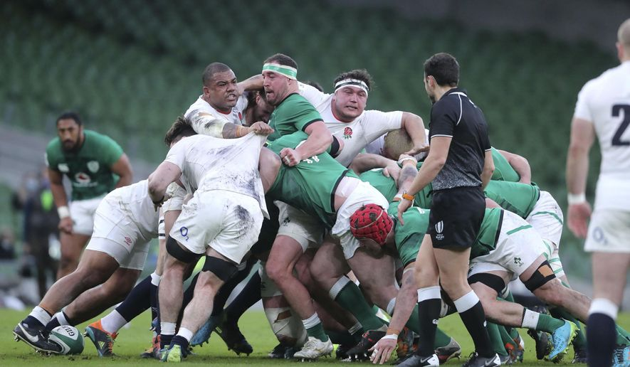 Ireland and England players compete in the scrum during the Six Nations rugby union international between Ireland and England at the Aviva Stadium, Dublin, Saturday March 20, 2021. (Niall Carson/Pool via AP)