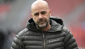 FILE - In this Sunday, March 14, 2021 file photo, Leverkusen coach Peter Bosz walks in the stadium before the Bundesliga soccer match between Bayer Leverkusen and Arminia Bielefeld in Leverkusen, Germany. Bayer Leverkusen has fired Peter Bosz as coach after the team's decline in form this year. (Ina Fassbender/Pool via AP, file)