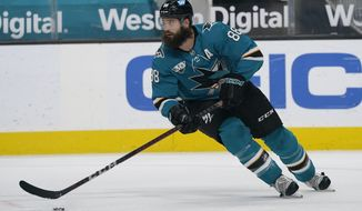 San Jose Sharks defenseman Brent Burns skates with the puck against the Los Angeles Kings during the second period of an NHL hockey game in San Jose, Calif., Monday, March 22, 2021. (AP Photo/Jeff Chiu)