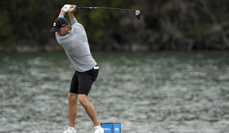 Jordan Spieth hits his tee shot on the 14th hole during a practice round for the Dell Technologies Match Play Championship golf tournament Monday, March 22, 2021, in Austin, Texas. (AP Photo/David J. Phillip)