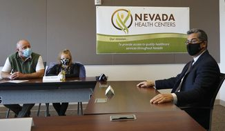 The U.S. Health and Human Services Secretary Xavier Becerra sits during a meeting at the Nevada Health Centers in Carson City, Nevada on Tuesday, March 23, 2021. Becerra visited Nevada on Tuesday to talk up the Affordable Care Act and efforts underway to expand coverage and reduce the cost of healthcare. (AP Photo/Samuel Metz)