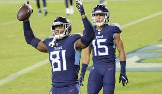 FILE - Tennessee Titans tight end Jonnu Smith (81) celebrates after scoring a touchdown on a 7-yard pass reception against the Buffalo Bills in the second half of an NFL football game in Nashville, Tenn., in this Tuesday, Oct. 13, 2020, file photo. The Patriots have agreed to sign free agent tight end Jonnu Smith in their biggest move to date to fill the void created by the departure of Rob Gronkowski. Smith, who was selected by the Titans in the third round of the 2017 draft, agreed Monday, March 15, 2021, to a four-year, $50 million deal, his agent Drew Rosenhaus told The Associated Press. (AP Photo/Mark Zaleski, File)