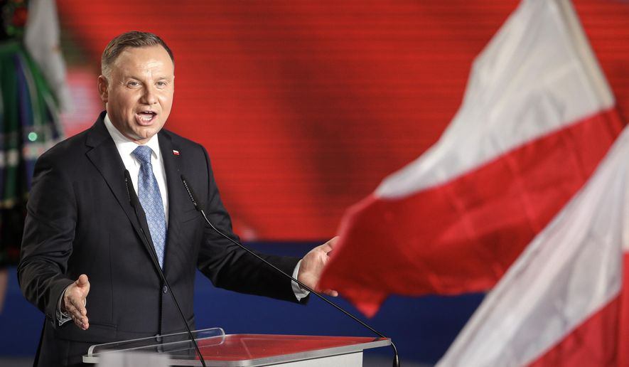 """In this Sunday, June 28, 2020 file photo, President Andrzej Duda addressees supporters after voting ended in the presidential election in Lowicz, Poland. A Polish writer is being threatened with up to three years of imprisonment for calling the nation's president a """"moron"""" on social media. The writer, Jakub Zulczyk,  had criticized the manner in which Polish President Andrzej Duda — a close ally of former President Donald Trump — had reacted to the electoral victory of President Joe Biden last year. (AP Photo/Petr David Josek, File) **FILE**"""