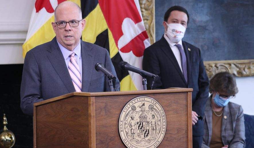 Maryland Gov. Larry Hogan talks about the opening of the next phase of COVID-19 vaccine eligibility for people 60 and older in Maryland on Tuesday, March 23, 2021, in Annapolis, Md. Chas Eby, the executive director of the Maryland Emergency Management Agency, and Secretary of the Maryland Department of Disabilities Carol Beatty (seated) are to Hogan's right. Hogan also announced plans for six more mass vaccination sites in the state with substantial increases in vaccine supply expected in the next couple of weeks. (AP Photo/Brian Witte)