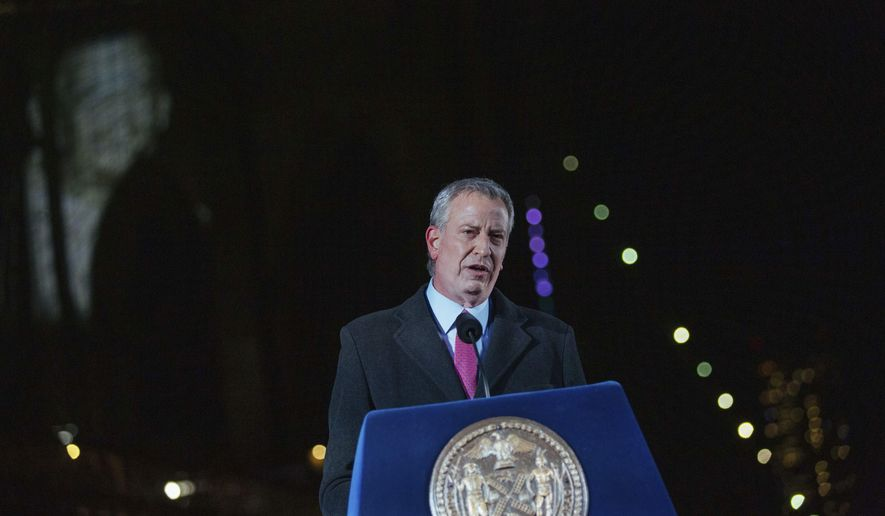 New York's Mayor Bill de Blasio speaks during a commemoration ceremony to remember New Yorkers lost during the Covid-19 pandemic Sunday, March 14, 2021, in Brooklyn, NY. (AP Photo/Kevin Hagen).