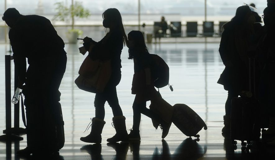 In this Wednesday, March 17, 2021, file photo, travelers walk through Salt Lake City International Airport in Salt Lake City. Airlines are dropping some of the temporary service changes they made during the early part of the coronavirus pandemic. (AP Photo/Rick Bowmer) **FILE**