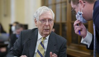 """Senate Minority Leader Mitch McConnell, R-Ky., turns to an aide as the Senate Rules Committee holds a hearing on the """"For the People Act,"""" which would expand access to voting and other voting reforms, at the Capitol in Washington, Wednesday, March 24, 2021. (AP Photo/J. Scott Applewhite) ** FILE **"""