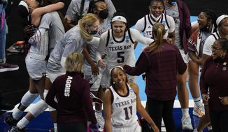 Texas A&M guard Jordan Nixon (5) celebrates with teammates after a college basketball game against Iowa State in the second round of the women's NCAA tournament at the Alamodome in San Antonio, Wednesday, March 24, 2021. Nixon's basket at the buzzer gave Texas A&M an 84-82 victory in overtime. (AP Photo/Eric Gay)