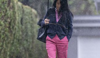 Chief Financial Officer of Huawei, Meng Wanzhou leaves her home in Vancouver, British Columbia, to go to British Columbia Supreme Court, Wednesday, March 24, 2021. (Jonathan Hayward/The Canadian Press via AP)