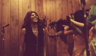 """This image released by HBO shows Tina Turner performing in 1973, from the documentary """"Tina."""" (Rhonda Graam/HBO via AP)"""
