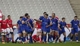 French players celebrate after France's Romain Taofifenua scored the opening try during the Six Nations rugby union international between France and Wales at the Stade de France in Saint-Denis, near Paris, Saturday, March 20, 2021. (AP Photo/Francois More)