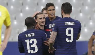 France's Antoine Griezmann, second left, celebrates after scoring opening goal during the World Cup 2022 group D qualifying soccer match between France and Ukraine at the Start de de France stadium, in Saint Denis, north of Paris, Wednesday, March 24, 2021. (AP Photo/Thibault Camus)