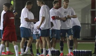 Norway players warm up ahead of the World Cup 2022 group G qualifying soccer match between Gibraltar and Norway in Gibraltar, Wednesday March 24, 2021. (AP Photo/Javier Fergo)