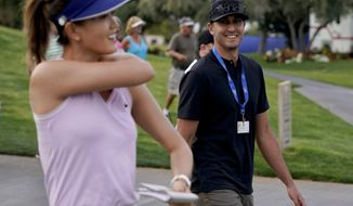 FILE - In this April 4, 2019, file photo, Michelle Wie, left, walks off the ninth green with Jonnie West during the first round of the LPGA Tour ANA Inspiration golf tournament at Mission Hills Country Club in Rancho Mirage, Calif. New mom Wie West is looking forward to being nervous again on the golf course. It's been nearly two years since Wie West last played a competitive round on the LPGA Tour, and nine months since she gave birth to daughter Makenna. (AP Photo/Chris Carlson, File)