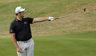 Jon Rahm, of Spain, reacts to his fourth shot on the fifth hole, during a first round match at the Dell Technologies Match Play Championship golf tournament Wednesday, March 24, 2021, in Austin, Texas. (AP Photo/David J. Phillip)