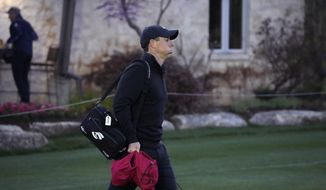 Rory McIlroy, of Northern Ireland, arrives on the driving range before the start of the first round match at the Dell Technologies Match Play Championship golf tournament Wednesday, March 24, 2021, in Austin, Texas. (AP Photo/David J. Phillip)
