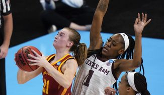 Iowa State guard Lexi Donarski (21) shoots ahead of Texas A&M guard Zaay Green (1) during the first half of a college basketball game in the second round of the women's NCAA tournament at the Alamodome in San Antonio, Wednesday, March 24, 2021. (AP Photo/Eric Gay)