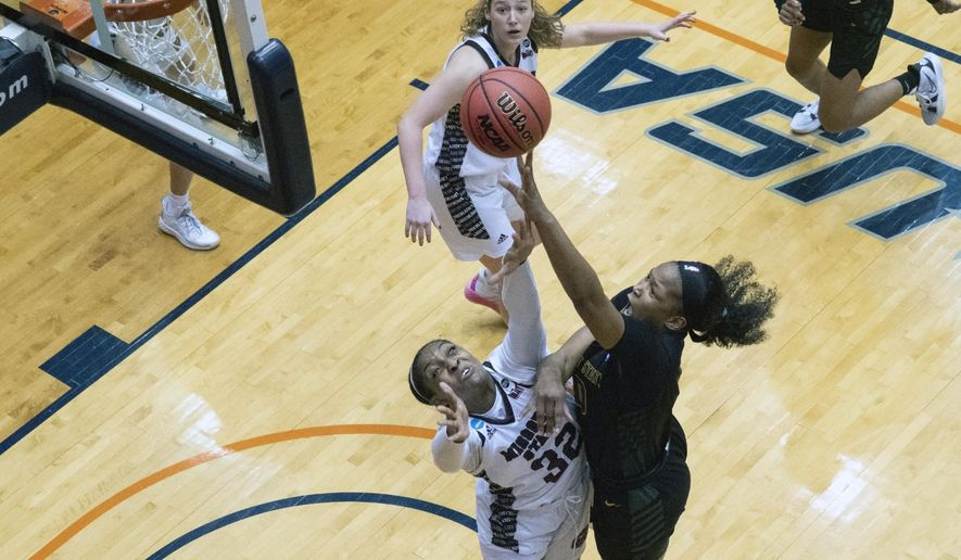 Wright State forward Shamarre Hale, right, puts up a shot against Missouri State forward Jasmine Franklin (32) during the first half of a college basketball game in the second round of the women's NCAA tournament at the University of Texas at San Antonio Convocation Center in San Antonio, Texas, Wednesday, March 24, 2021. (AP Photo/Michael Thomas)