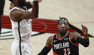 Brooklyn Nets forward Jeff Green, left, shoots as Portland Trail Blazers forward Robert Covington, right, defends during the first half of an NBA basketball game in Portland, Ore., Tuesday, March 23, 2021. (AP Photo/Steve Dipaola)