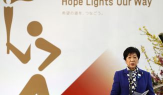 Tokyo Gov. Yuriko Koike delivers a speech during the Grand Start of the Olympic Torch Relay in Naraha, Fukushima prefecture, northeastern Japan, Thursday, March 25, 2021. The torch relay for the postponed Tokyo Olympics began its 121-day journey across Japan on Thursday and is headed toward the opening ceremony in Tokyo on July 23. (Kim Kyung-Hoon/Pool Photo via AP)