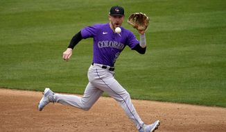 Colorado Rockies' Trevor Story fields a ground out hit by Oakland Athletics' Jed Lowrie during the second inning of a spring training baseball game, Tuesday, March 23, 2021, in Mesa, Ariz. (AP Photo/Matt York) **FILE**