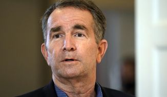 This Monday, March 15, 2021, photo shows Virginia Gov. Ralph Northam at the Governor's Mansion in Richmond, Va.  (AP Photo/Steve Helber)  **FILE**