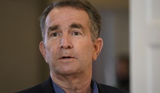 This Monday, March 15, 2021 file photo shows Virginia Gov. Ralph Northam at the Governor's Mansion in Richmond, Va. A bill that recently passed the Democrat-controlled General Assembly aims to fix several issues with Virginia's unemployment system that were laid bare by the pandemic. (AP Photo/Steve Helber) **FILE**