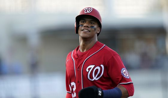 Washington Nationals' Juan Soto goes to the dugout after being thrown out at second during the second inning of a spring training baseball game against the Houston Astros, Wednesday, March 24, 2021, in West Palm Beach, Fl. (AP Photo/Lynne Sladky) **FILE**