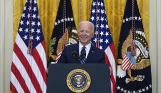 President Joe Biden smiles as he speaks during a news conference in the East Room of the White House, Thursday, March 25, 2021, in Washington. (AP Photo/Evan Vucci)