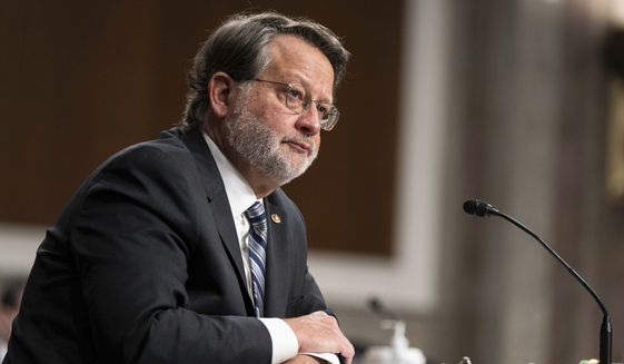 Sen. Gary Peters., D-Mich., speaks during a hearing to examine United States Special Operations Command and United States Cyber Command in review of the Defense Authorization Request for fiscal year 2022 and the Future Years Defense Program, on Capitol Hill, Thursday, March 25, 2021, in Washington. (Anna Moneymaker/The New York Times via AP, Pool)