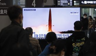 """People watch a TV showing a file image of North Korea's missile launch during a news program at the Suseo Railway Station in Seoul, South Korea, Thursday. March 25, 2021. North Korea on Thursday test-fired its first ballistic missiles since President Joe Biden took office, as it expands its military capabilities and increases pressure on Washington while nuclear negotiations remain stalled. The Korean letters read: """"North Korea launches missiles this morning."""" (AP Photo/Ahn Young-joon)"""