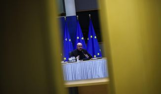 European Council President Charles Michel talks during a video conference with the leaders of Germany, France, Portugal and Greece ahead of the EU summit at the European Council headquarters in Brussels, Tuesday, March 23, 2021. (AP Photo/Francisco Seco, Pool)