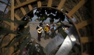 Hired musicians perform as family members attend the burial service of a relative who died from COVID-19 in the Chalco cemetery just outside Mexico City, Wednesday, March 17, 2021, amid the new coronavirus pandemic. (AP Photo/Fernando Llano)