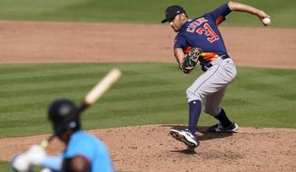 Houston Astros relief pitcher Steve Cishek (31) throws to Miami Marlins' Lewin Diaz during the seventh inning of a spring training baseball game, Friday, March 5, 2021, in Jupiter, Fla. (AP Photo/Lynne Sladky)