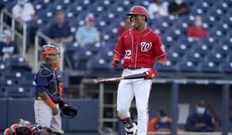 Washington Nationals' Juan Soto (22) reacts after drawing a walk during the second inning of a spring training baseball game against the Houston Astros, Wednesday, March 24, 2021, in West Palm Beach, Fla. (AP Photo/Lynne Sladky) **FILE**