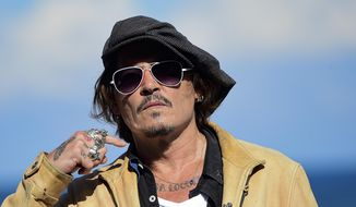 """In this file photo dated Sunday, Sept. 20, 2020, US actor and film producer Johnny Deep during the photocall for his film """"Crock of Gold: A Few Rounds with Shane Macgoman"""" at the 68th San Sebastian Film Festival, in San Sebastian, northern Spain. Appeal judges said the Hollywood star cannot challenge the High Court's rejection of his libel lawsuit against publisher of The Sun newspaper for labeling him a """"wife beater"""" in an article. High Court Justice Andrew Nicol ruled in November that allegations against Depp, made in a April 2018 article, were """"substantially true."""" The judges said Thursday that the earlier court hearing was """"full and fair"""" and the justice's conclusions """"have not been shown even arguably to be vitiated by any error of  approach or mistake of law."""" (AP Photo/Alvaro Barrientos, File)"""