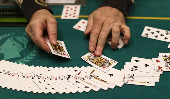 In this Feb. 27, 2013 file photo Jeff Martos resets a deck of cards during a break in poker play at Caesar's Palace, in Las Vegas.  (AP Photo/Julie Jacobson, File)  **FILE**