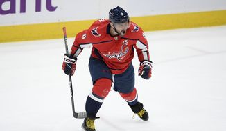 Washington Capitals left wing Alex Ovechkin celebrates his goal during the second period of the team's NHL hockey game against the New Jersey Devils, Thursday, March 25, 2021, in Washington. (AP Photo/Nick Wass) **FILE**