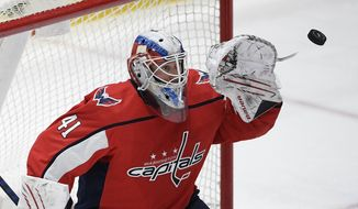 Washington Capitals goaltender Vitek Vanecek prepares to catch the puck during the second period of the team's NHL hockey game against the New Jersey Devils, Thursday, March 25, 2021, in Washington. (AP Photo/Nick Wass)