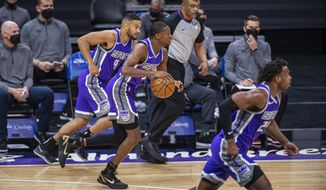 Sacramento Kings guard De'Aaron Fox (5) drives to the basket after guard Cory Joseph (9) stole the ball from the Atlanta Hawks during the first quarter of an NBA basketball game in Sacramento, Calif., Wednesday, March 24, 2021. (AP Photo/Hector Amezcua)